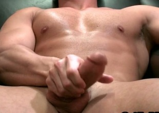 Muscled straight guy jerking his fixed cock
