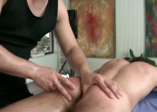 Artless guy getting his hard unearth sucked by happy-go-lucky masseur
