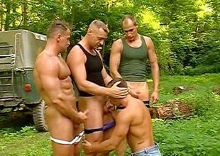 Muscled hiker gets banged by three bodybuilders