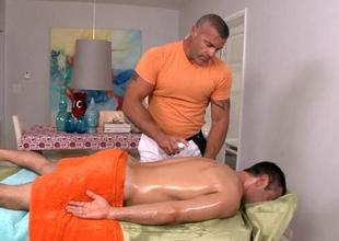 Twink is giving a blowjob be required of poncey masseur
